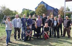 Mitarbeiter von Pro Mobil und RWE posieren für ein Foto